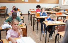 Pupils sitting in class Stock Photos