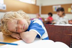 Boy felt asleep during class Stock Photos