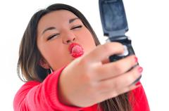 woman in red talking on cellphone - stock photo