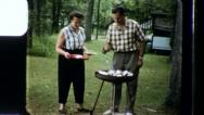 Stock Video Footage of Man Woman Serve BARBECUE BBQ 1960s (Vintage Film 8mm Retro Home Movie) 3416
