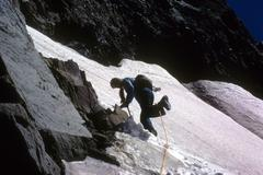 Young woman descending snowfield Stock Photos