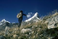 andean guide with alpa mayo in background - stock photo