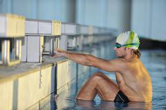 young swimmmer on swimming start - stock photo