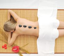 Massage with hot volcanic stones Stock Photos