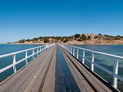 Old pier at granite island and victor harbor Stock Photos