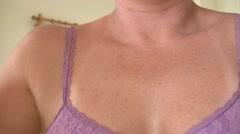 Woman applying deodorant Stock Footage