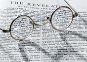 Stock Photo of antique reading glasses on page of bible