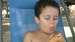 Little boy eating burger - stock footage