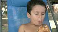 Stock Video Footage of Little boy eating burger