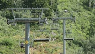 Summer mountain resort family on ski lift fast HD 2774 Stock Footage