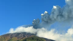 Tungurahua volcano in Ecuador, high pressure gases and ash is blown into the sky - stock footage