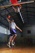 Basket ball game player at sport hall Stock Photos