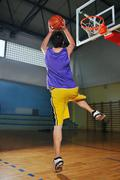 Stock Photo of basket ball game player at sport hall