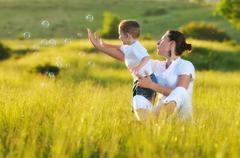 Woman child bubble Stock Photos