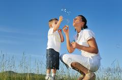 Woman child bubble Stock Photos