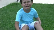 Injured little boy crying Stock Footage