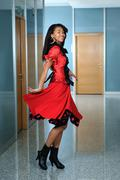 Stock Photo of woma in red dres dancig