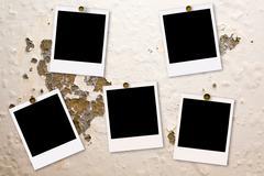 Polaroid films on damaged wall Stock Photos
