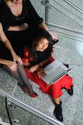 Stock Photo of business woman with laptop on staircase