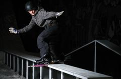 Freestyle snowboarder jump in air at night Stock Photos