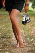 Bare foot woman walk outdoor Stock Photos
