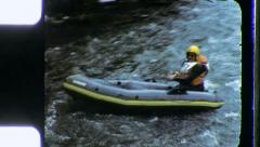 RAFTER KAYAKING on Wild River Circa 1970 (Vintage 8mm Home Movie Footage) 3469 - stock footage