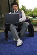 Stock Photo of young adult working on laptop