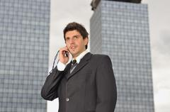 Photo of happy winner businessman  talking on mobile phone Stock Photos