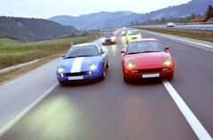 tuning cars sacing down the highway - stock photo