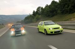 Tuning cars sacing down the highway Stock Photos