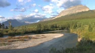 Mount Stream in Glacier NP TimeLapse w/ fast moving clouds Stock Footage