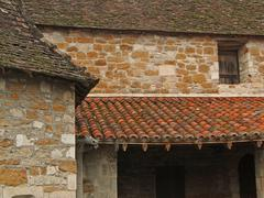 Tiled  roof and stone wall of the cloister Stock Photos