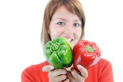 pretty girl with pepper isolated - stock photo