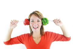 Stock Photo of pretty girl with pepper isolated