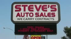 Steves Auto Sales Obama small business HD 2856 Stock Footage