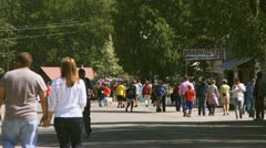 Summertime Tourists Walking in Talkeetna, AK Stock Footage