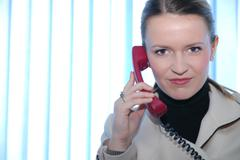 .businesswoman talking by phone - stock photo