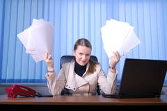 Stock Photo of .businesswoman holding empty documents