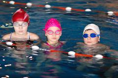 .childrens having fun in a swimming pool - stock photo
