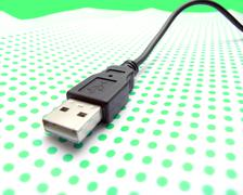 usb cable on dotted background - stock photo
