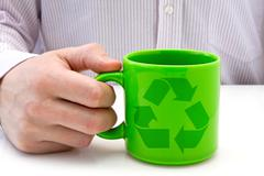 Stock Photo of hand hold a  cup with recycled symbol