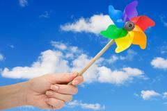 hand holding pinwheel - stock photo