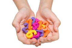 Hands holding plastic numbers Stock Photos