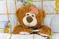 ill brown teddy-bear - stock photo