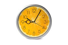 Orange fruit clock Stock Photos