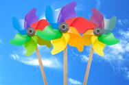Pinwheel toys against blue sky Stock Photos