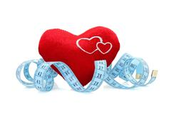 Stock Photo of red heart with measure tape