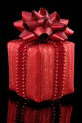 Stock Photo of red gift on black background