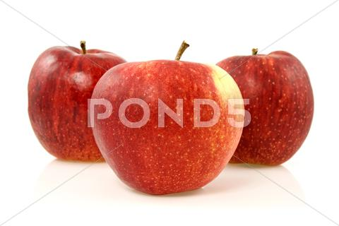 Stock photo of three red apples