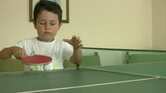 Little boy learning ping pong Stock Footage
